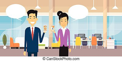 Asian Business Man And Woman Hold Cell Smart Phone Chat...