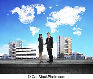 Asian business man and woman shaking hand