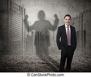 Asian business man casting a shadow of strength