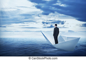 Asian business man standing on the boat