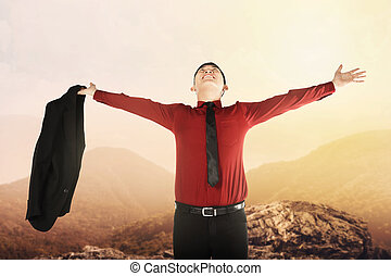 Asian business man standing on the mountain