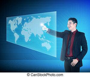 Asian business man touching world on virtual screen