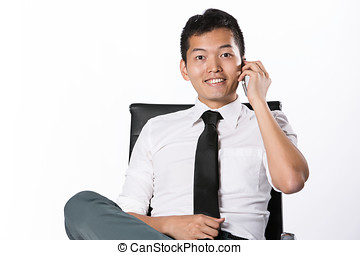 Asian business man using mobile phone - Portrait of an Asian...