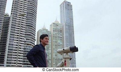 Asian business man with binoculars