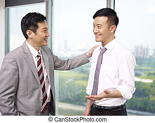 asian business people - asian businessman standing and...