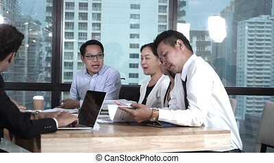 Asian business people discuss marketing strategy. - Asian ...