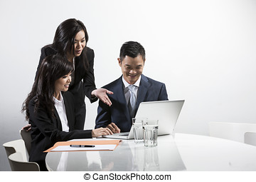 Asian business people having a meeting together - Group of...