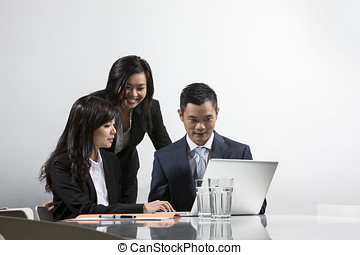 Asian business people having a meeting together