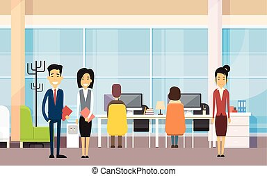 Asian Business People In Modern Office Work On Computer