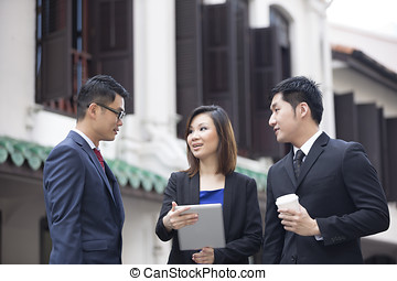 Asian Business people outside with tablet
