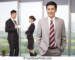 asian business people - portrait of a senior business ...