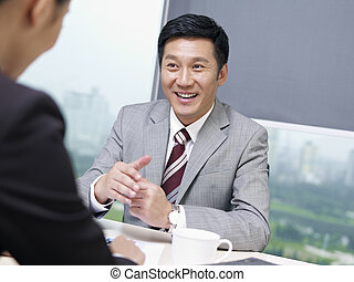 asian business people discussing business in office.