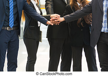 Asian Business Team showing Unity with their hands together