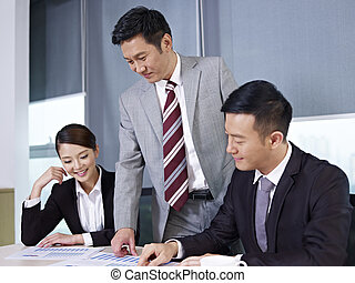 asian business team - a team of asian business people...