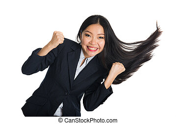 asian business woman celebrating success with hair swinging