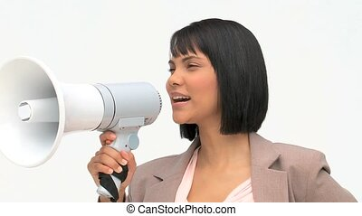 Asian business woman giving orders through a loudspeaker...