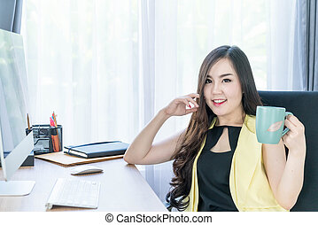 asian business woman happy with coffee cup