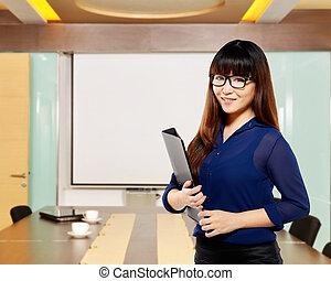 Asian business woman holding folder