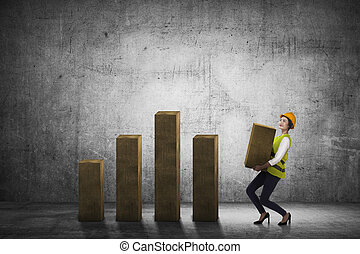 Asian business woman lifting block of chart