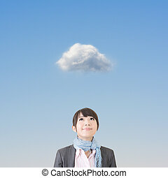 Asian business woman looking up on cloud