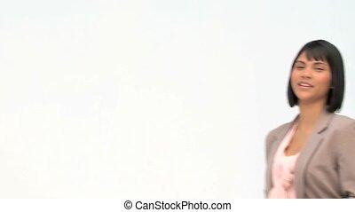Asian business woman shouting through a megaphone