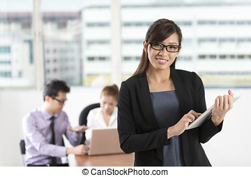 Asian business woman standing in office