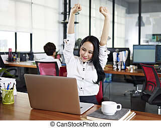 asian business woman stretching arms in office - asian...