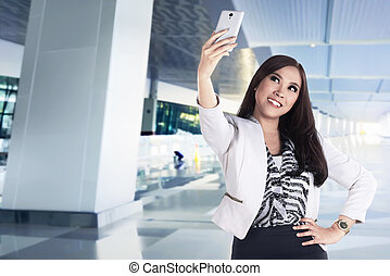Asian business woman take selfie with her smartphone
