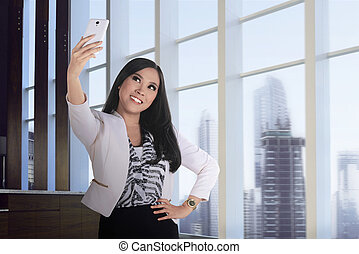 Asian business woman take selfie