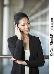 Asian business woman using smartphone.