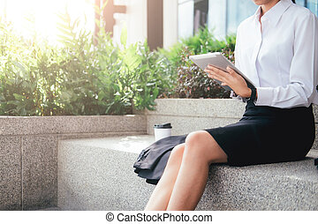 Asian business woman working outdoor.