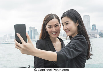 women take a selfie
