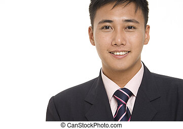 Asian Businessman 2 - A young asian businessman in a sharp ...