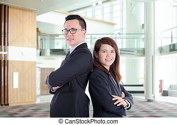 Asian businessman and businesswoman at office