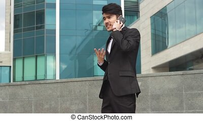 Asian businessman boss talking by phone and walking around