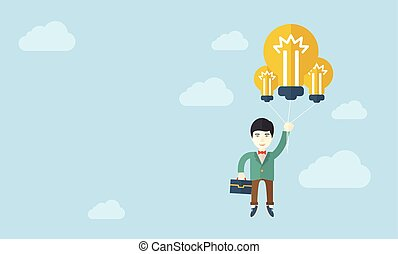 Asian businessman carrying a briefcase with bulb.