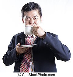 Asian Businessman drink the coffee
