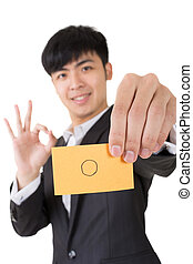 circle shape - Asian businessman holding a card written on...