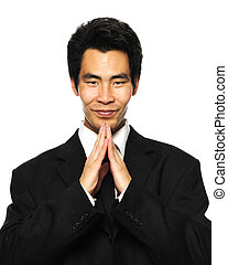 Asian businessman in dark suite greeting visitor