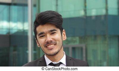 Asian businessman looking in camera