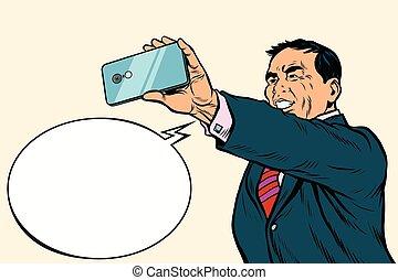 Asian businessman makes selfie