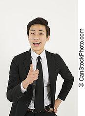 Asian businessman pointing at you