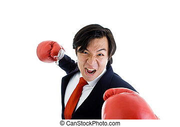 Asian businessman punching at/threatening the camera.  Isolated on white background.