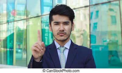 Asian businessman saying No