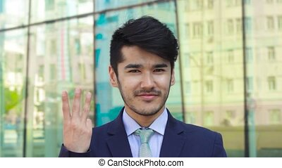 Asian businessman show finger up or idea outdoor