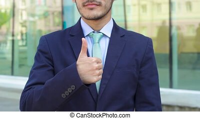 Asian businessman show gesture thumbs up