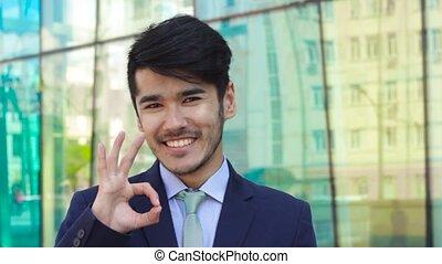 Asian businessman show OK