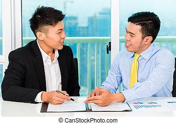 Asian businessman sign agreement