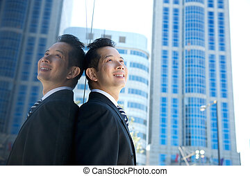 Asian businessman smiling in the city