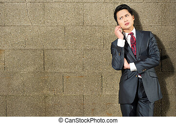 Asian Businessman Speaking on Phone